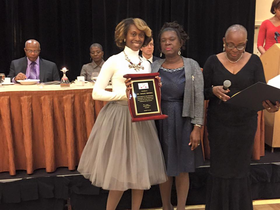 A family member receives the honor on behalf of Honoree Violet Jeffers